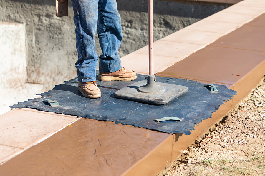 worker standing in the mat