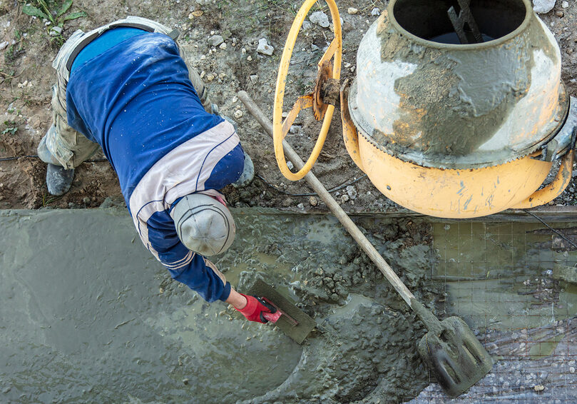 worker using a trowel in the cement